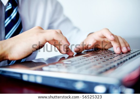 Businessman typing on his laptop - stock photo