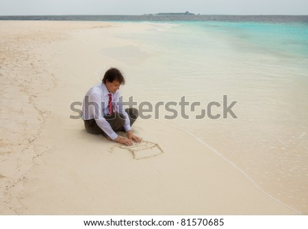 Businessman typing on keyboard of laptop drawn on the sand