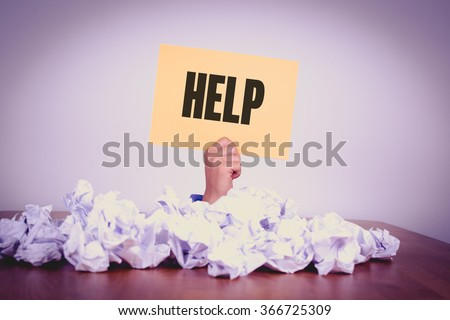 Businessman under crumpled pile of papers with hand holding a HELP Sign - stock photo