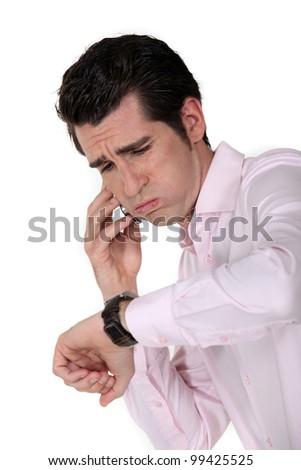 businessman under pressure consulting his watch - stock photo