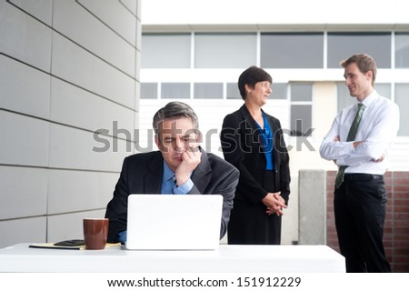Businessman under stress, fatigue and headache at the office - stock photo