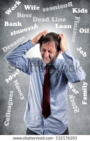 Businessman under stress on gray background - stock photo