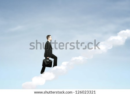 businessman up stairs out of clouds - stock photo