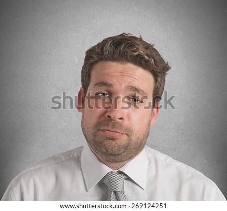 Businessman upset and stressed out from work - stock photo