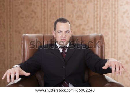 Businessman upset seated on a chair - stock photo