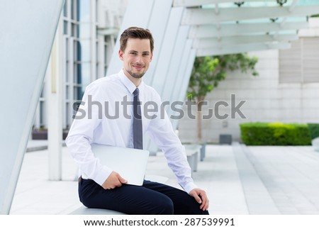 Businessman use of notebook computer at outdoor