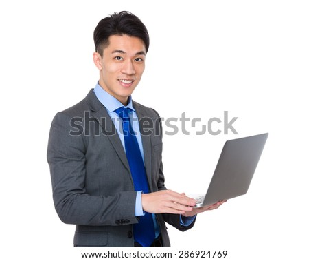 Businessman use of portable computer - stock photo