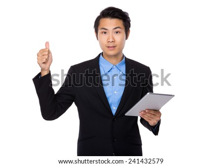 Businessman use of tablet and thumb up