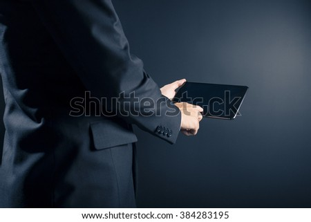 Businessman Use Tablet on Isolated  Background - stock photo