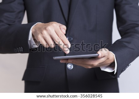 Businessman Use Tablet on Isolated White Background