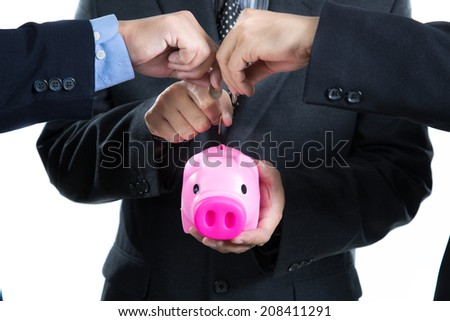 Businessman used hands for insert coin to piggy bank for deposit thier investment in the future