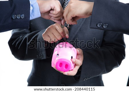 Businessman used hands for insert coin to piggy bank for deposit thier investment in the future - stock photo