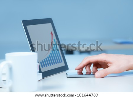 Businessman uses the new media technologies and devices to work successfully. - stock photo