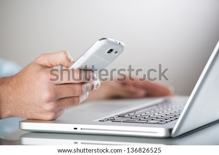 Businessman uses the new media technologies and devices to work successfully - stock photo