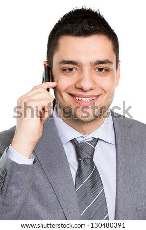 Businessman using a cell phone, isolated on white