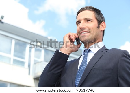 Businessman using a cellphone - stock photo