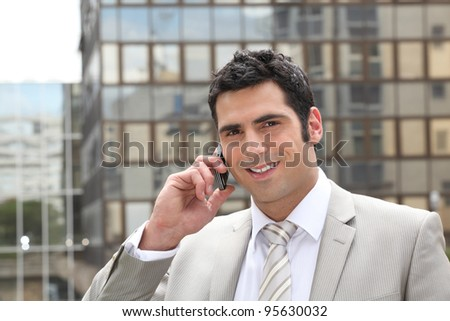 Businessman using a cellphone - stock photo