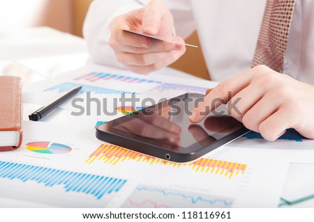 Businessman using a credit card and digital tablet for buying on-line - stock photo