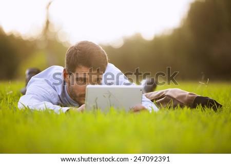 Businessman using a digital tablet - stock photo