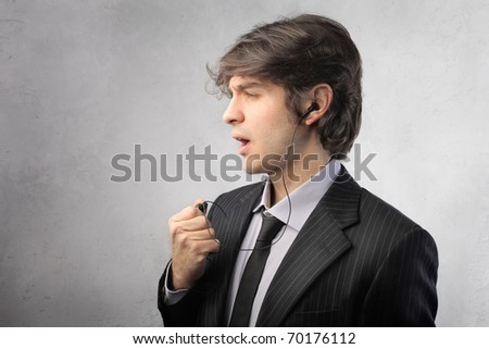 Businessman using a hands-free headset - stock photo