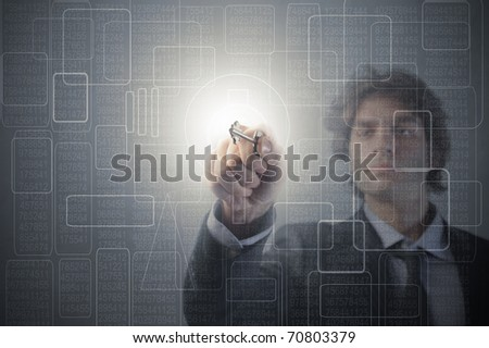 Businessman using a key on a touchscreen