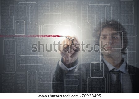 Businessman using a key on a touchscreen - stock photo