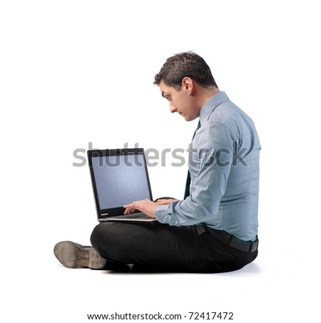 Businessman using a laptop - stock photo