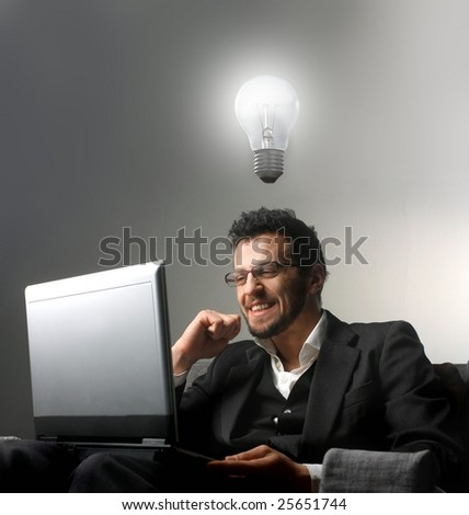businessman using a laptop and having an idea - stock photo
