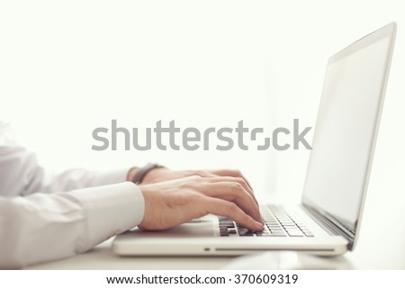 Businessman using a laptop computer at the office