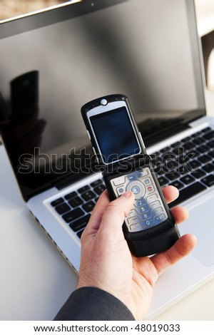 businessman using a mobile phone and laptop - stock photo