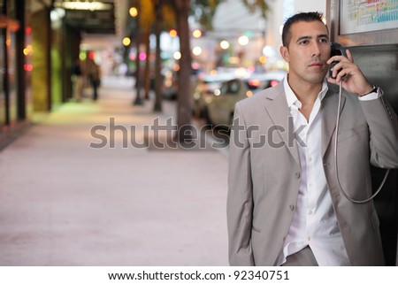 Businessman using a pay phone