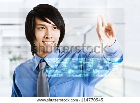 Businessman using a touchscreen device - stock photo