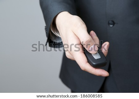Businessman using car key. Keyless in male hand - stock photo