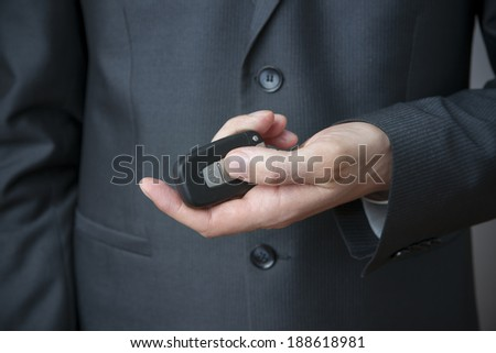 Businessman using car key. Keyless in male hand