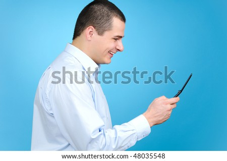 Businessman using cell phone on blue background