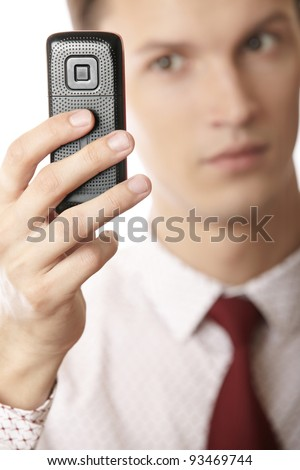 Businessman using cellular phone as GPS and internet device - stock photo