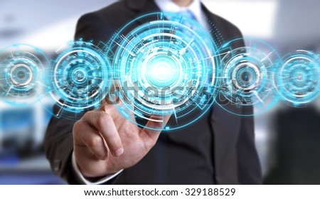 Businessman using digital interface with his fingers in his office
