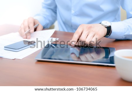 Businessman using digital tablet computer with modern mobile phone. New technologies for success workflow concept. - stock photo
