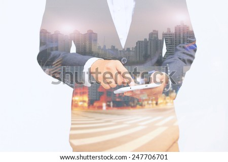 Businessman using digital tablet.double exposure of businessman. - stock photo