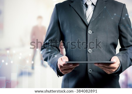 businessman using digital tablet with blurred background.Forex graph on the business background. A metaphor of international financial consulting.investment concept - stock photo