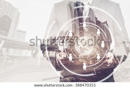 businessman using digital tablet with the small world and social media icon, internet concept (Elements of this image furnished by NASA) - stock photo