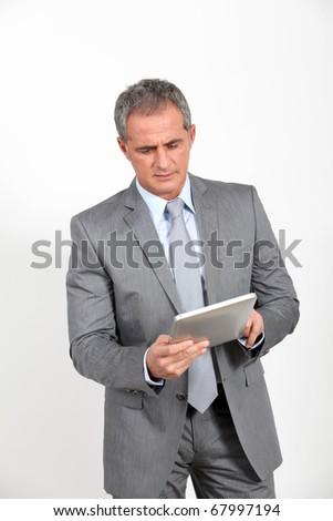 Businessman using electronic tab - stock photo