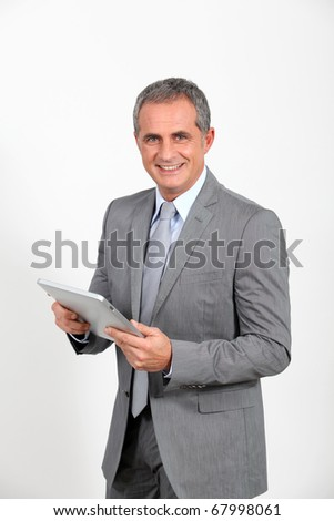 Businessman using electronic tab - stock photo