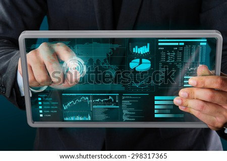 businessman using futuristic transparency mobile device  - stock photo