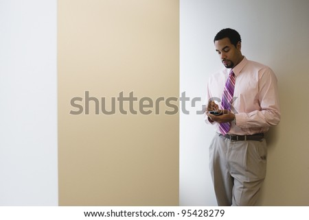 Businessman using hand held device