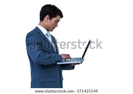 Businessman using his computer on white screen - stock photo