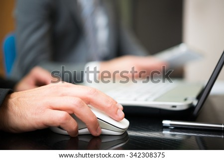 Businessman using his laptop in the office - stock photo