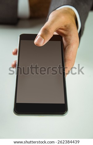 Businessman using his smart phone in close up