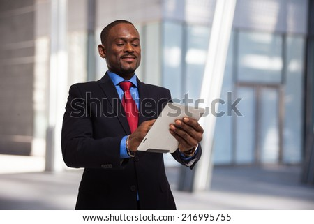 Businessman using his tablet compute - stock photo