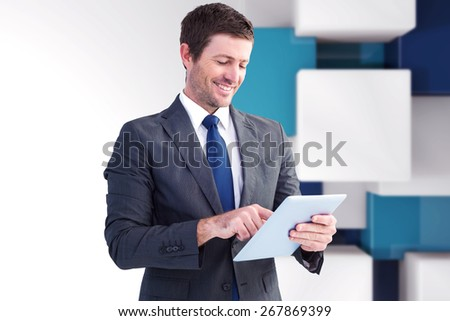 Businessman using his tablet pc against abstract background - stock photo